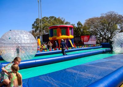Gladiator Inflatables is a leading jumping castle hire company in Randburg. The dozens of testimonials from happy customers speak volumes about the company's reliable service. This image was edited by Gladiator Inflatebles from Gauteng, South Africa. There are so many colours that our jumping castles all together look like a giant rainbow coloured inflatable.